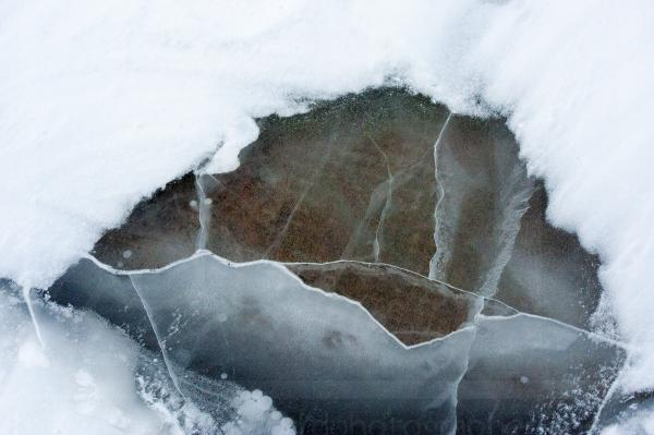 Rock Under Frozen Lake